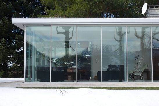 extension with heated slim sliding glass doors for snow melting and removal