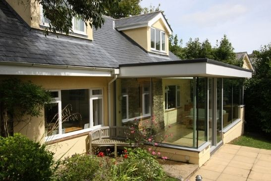 home extension on a property in a conservation area featuring large glazing elevations to create a contemporary extension design
