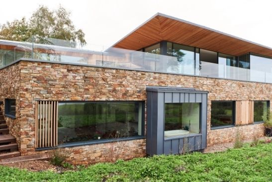 large glazing elevations used on a new build home to maximise natural light within the property including minimal windows slim framed glass doors