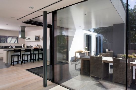 large sliding glass doors from minimal windows with black frames to complement the modern design elements