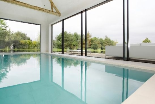low iron glass sliding glass doors from minimal windows used around an indoor pool area
