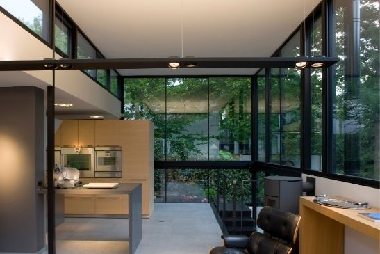 low maintenance glass used for a double height glazing elevation including minimal windows slim sliding doors