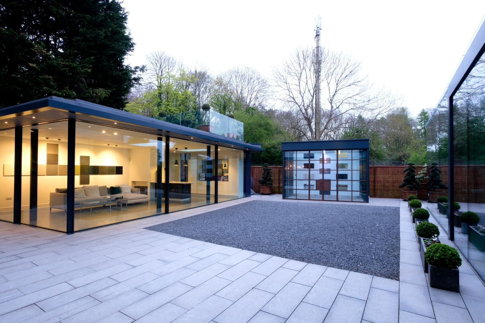 minimal windows showroom in Amersham - UK - with a wide rnage of glazing solutions including a minimal windows pivot door and multiple slim sliding doors