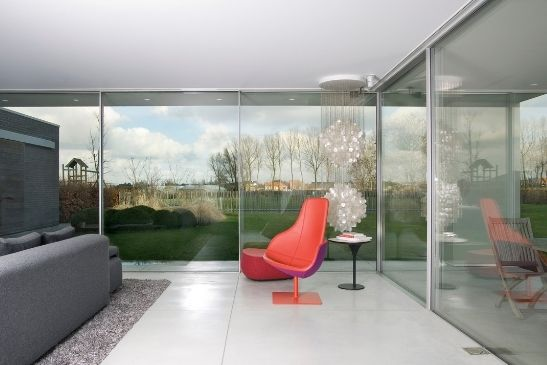 modern home extension with minimal windows sliding glass doors used to form entire sliding glass walls