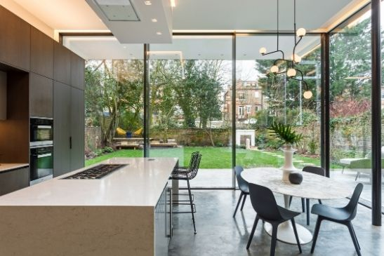 oversized corner opening slim sliding glass doors in a corner opening configuration in this modern extension