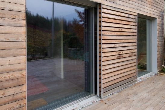 property with eco friendly timber cladding and minimal windows aluminium sliding doors in pocket configurations
