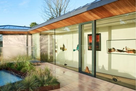 solar control glass used on a luxury new build home which had floor to ceiling glass walls and slim sliding doors to prevent spaces overheating