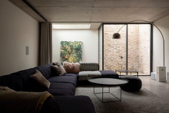 award winning field house project with minimal windows slim sliding doors around an internal courtyard for natural light