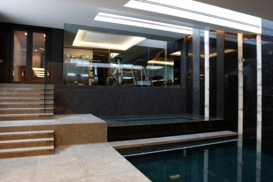 luxury basement renovation with an indoor pool and home gym