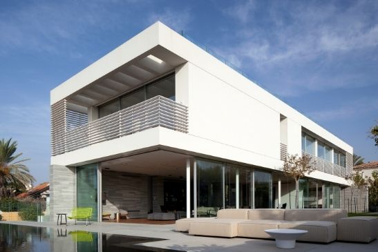 contemporary new build home with corner opening sliding glass doors from minimal windows