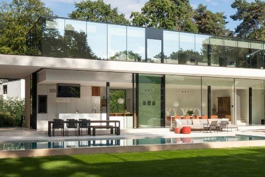 corner opening slim sliding doors form minimal windows in a modern kitchen of a luxury new build home