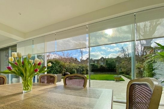 internal blinds to provide solar shading by large slim sliding doors with minimal aluminium framing