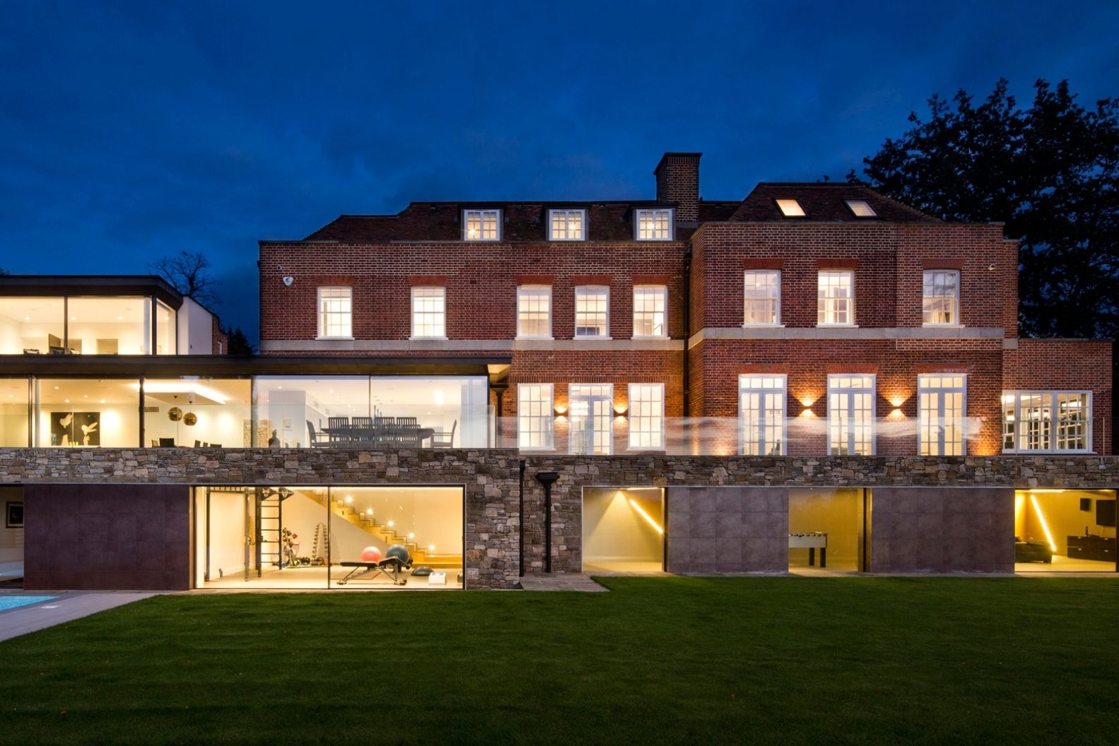 luxury four storey new build home with two pane minimal windows sliding glass doors