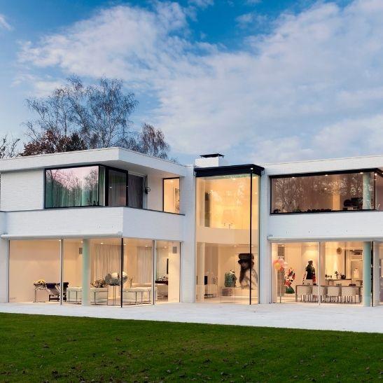 luxury new build home featuring multiple minimal windows triple glazed sliding glass doors