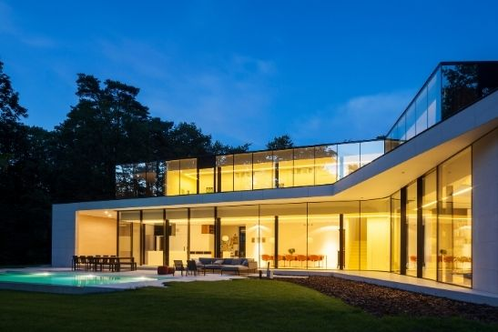 minimal windows floor to ceiling slim sliding doors create entire moving glass walls in a luxury new build home