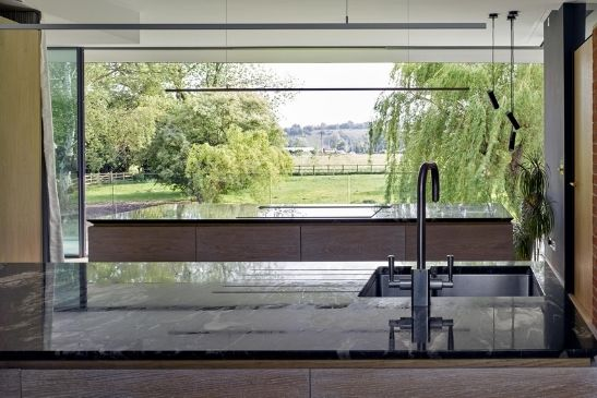 minimal windows luxury sliding glass doors open to reveal a large clear structural opening