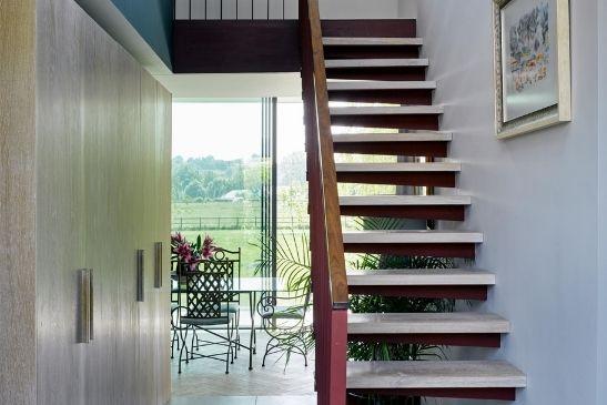 modern home entranceway leading to minimal windows slim sliding glass doors
