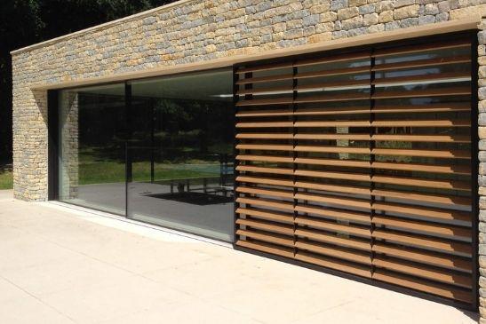 timber brise soleil system - sliding wooden shutters over slim sliding doors