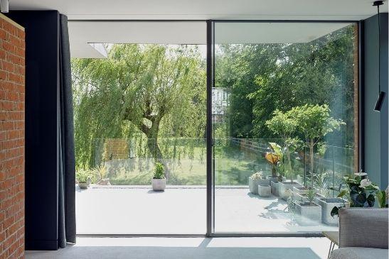 two pane minimal windows sliding door with a lever thrust locking