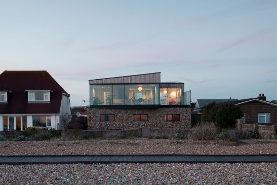 modern luxury coastal home built with stoner eternal building finishes to blend in with the pebble beach