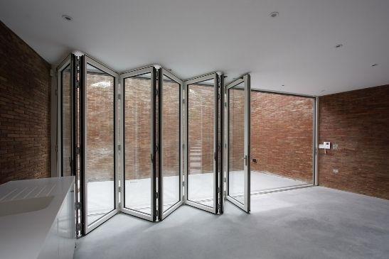 bifold doors with white aluminium framing and a flush threshold