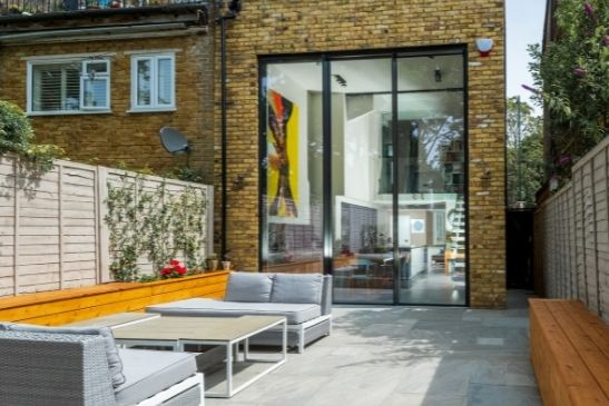 three pane double height sliding glass door for a breathtaking glazing solutions that has the wow factor