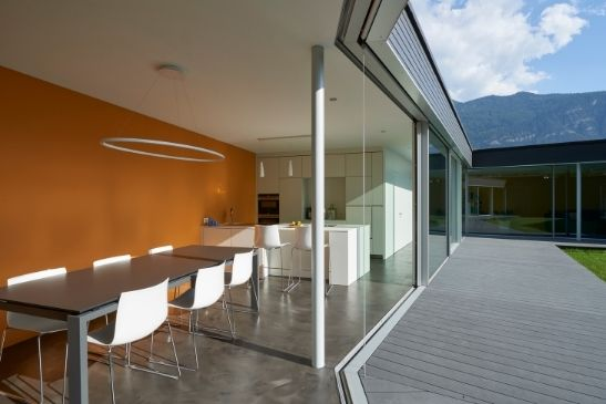 sliding minimal windows corner opening sliding glass doors opening at a wide angle