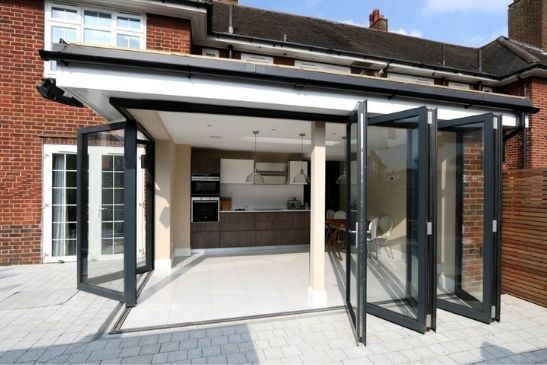 bifold doors in a corner opening configuration in a modern home extension