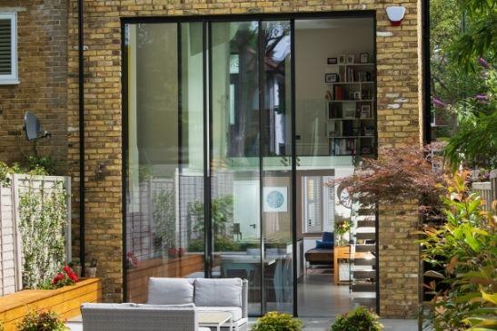 minimal windows slim sliding doors that reach an impressive 4.5m tall