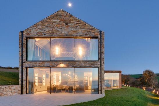 breathtaking luxury coastal home with oversized sliding glass doors to maximise views of the coast
