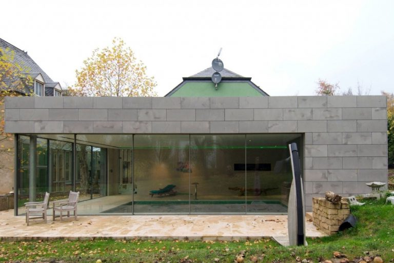 contemporary extension on an old building with minimal windows sliding glass doors