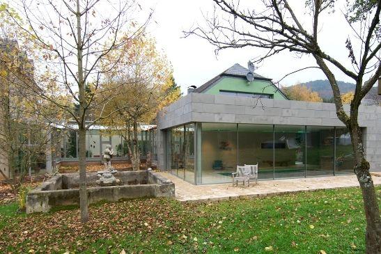 contemporary pool house extension featured minimal windows slim framed aluminium sliding doors