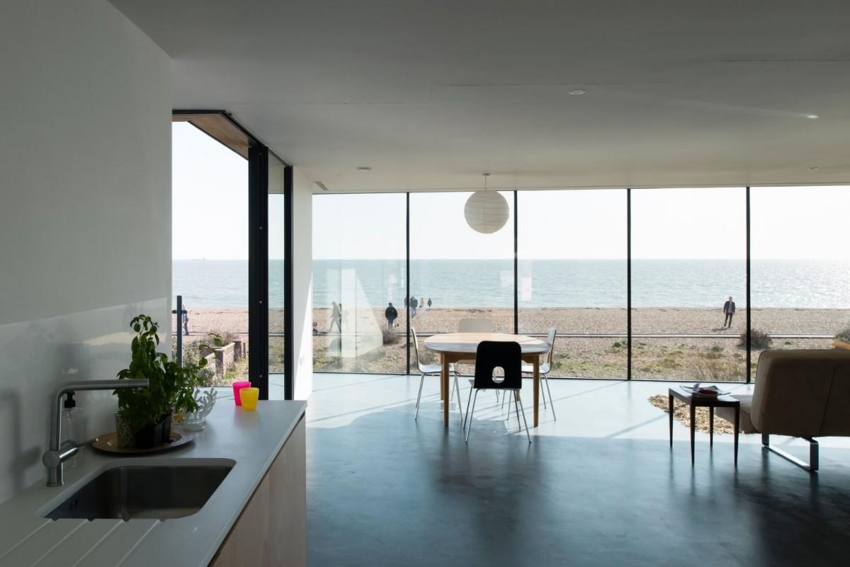 floor to ceiling glass walls with corner opening minimal windows sliding glass doors