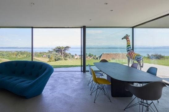 floor to ceiling minimal windows sliding glass doors with a stunning sea view by the coast