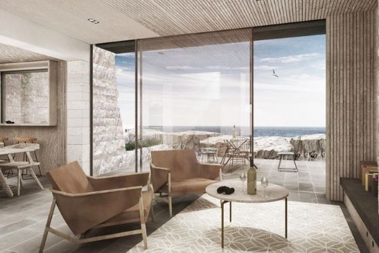 holiday home designed to blend into the cliffside with large sliding glass doors o maximise views