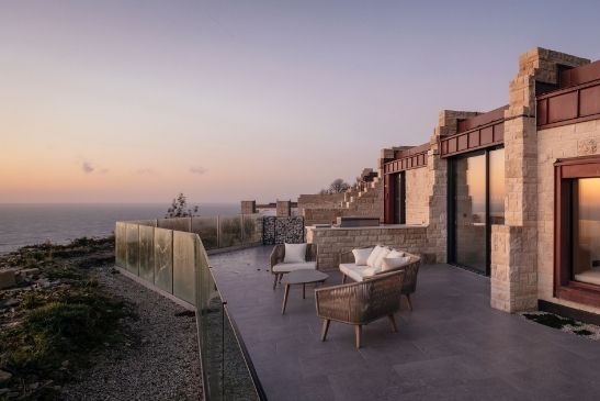 luxury cliffside holiday homes with stunning sea views and minimal windows sliding glass doors