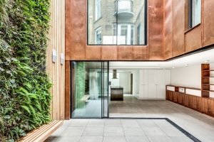 minimal windows corner opening slim sliding glass doors below a juliet balcony with sliding glass doors in a luxury residential development