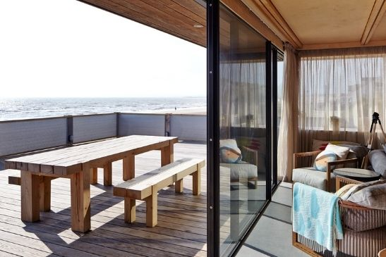 minimal windows sliding glass doors with marine grade aluminium frames on a waterfront luxury home