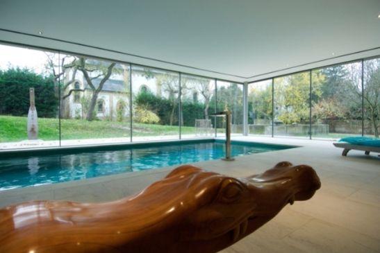 slim framed aluminium sliding doors from minimal windows around a luxury indoor pool area