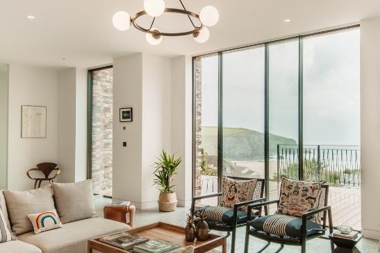 two pane aluminium sliding glass doors in a luxury coastal home with clear sea views