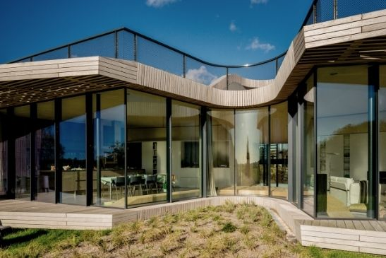 two pane minimal windows sliding glass doors and structural glazing with curved glass