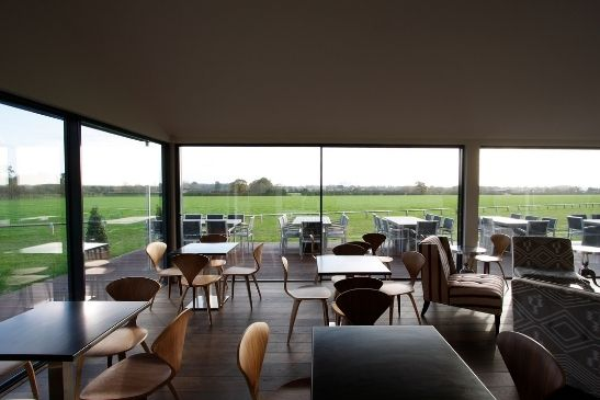 ultra minimal and slim framed sliding glass doors with clear view of the Emsworth polo club field