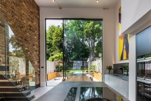 4.5m tall double height sliding glass doors in a luxury London home renovation