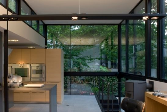 double height glass façade around a luxury home used fixed glazing to create double height glass walls