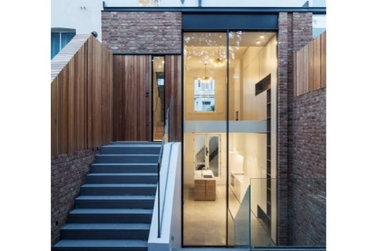 double height oversized slim sliding doors with ultra-minimal framing