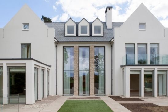 three double height automated vertical sash windows in a luxury new build home