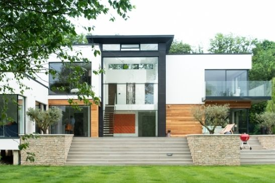 three pane vertical sliding sash window creating a 12m tall glass façade with an opening