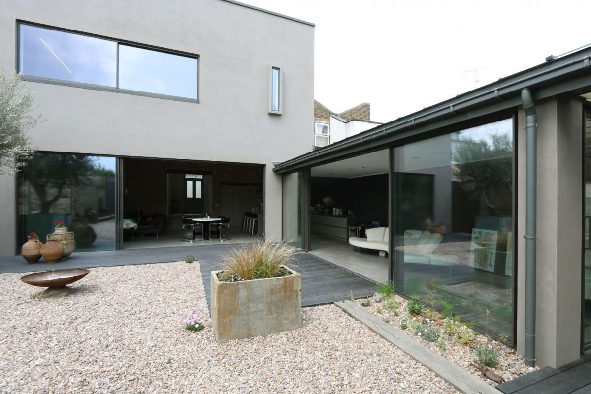 three pane slim sliding glass door and a minimal windows biparting sliding glass door